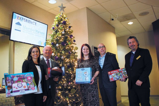 Community members <em>from left</em> Amber Jones, Joe Dorman, Miranda Hines, Scott Bell and Mitchell Rozin behind Oklahoma Institute for Child Advocacy and OK Foster Wishes' gift drive for foster children and teenagers encourage the community to donate. (Laura Eastes)