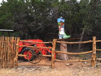 """Boot Scootin' to the Chapel"" is placed on the re-purposed Ancient Bald Cypress tree stump and stand."