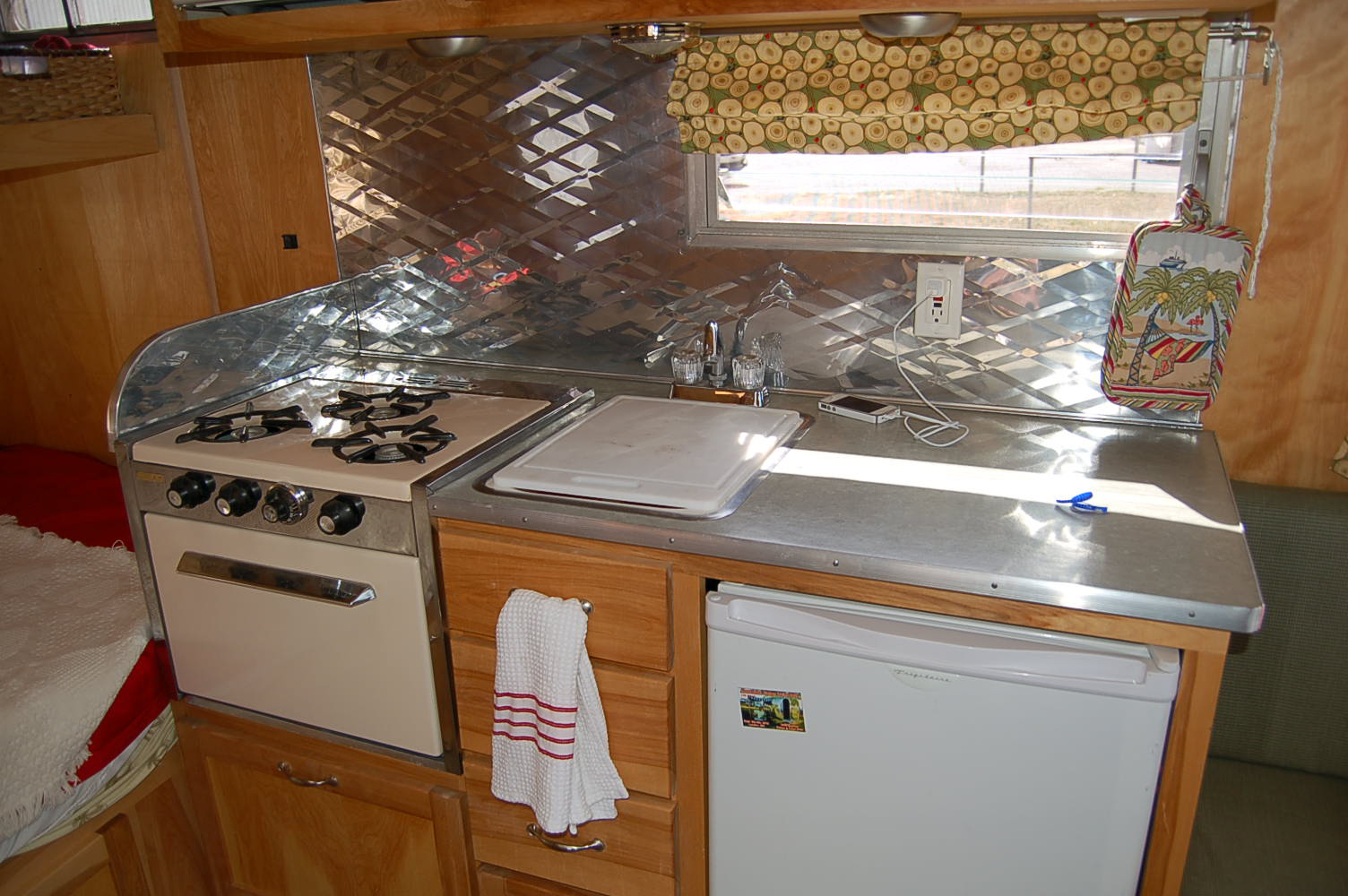 vintage aloha trailer pictures rv kitchen cabinets Beautiful kitchen countertop stove and cabinets in vintage Aloha travel trailer