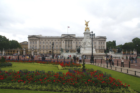 Buckingham Palace across from a flower garden