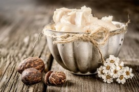 Shea butter and nuts on a wood