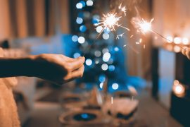 close-up-photograph-of-two-person-holding-sparklers-834894