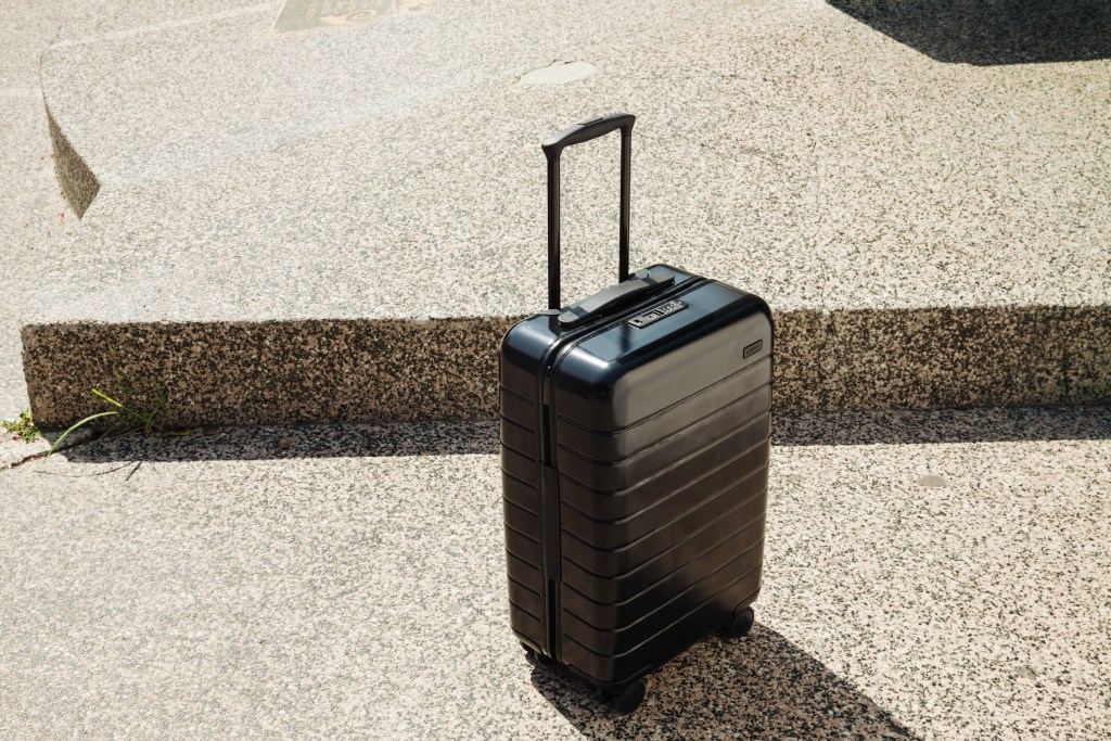 Away carryon suitcase usb charge
