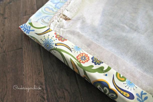 Pinning fabric on cushion {Onekriegerchick.com}