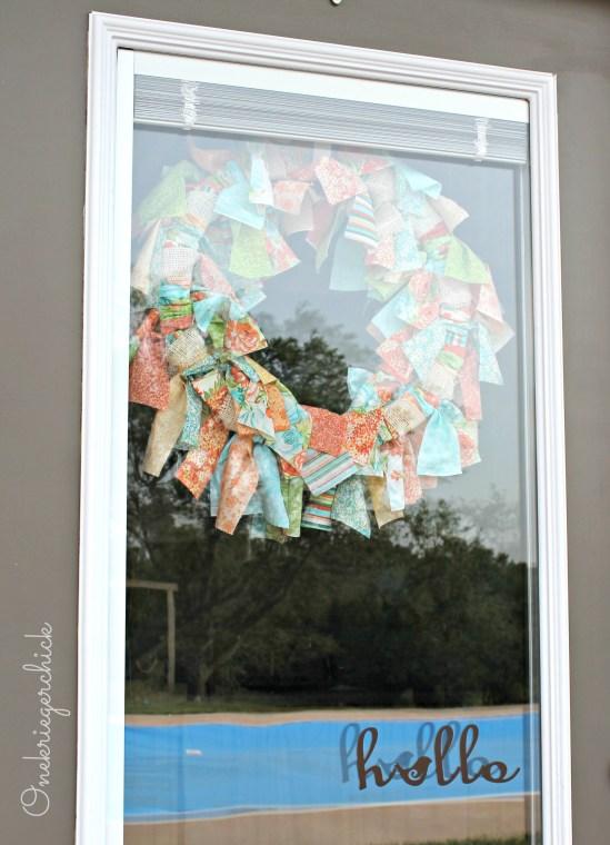Fabric scrap wreath inside door {Onekriegerchick.com}