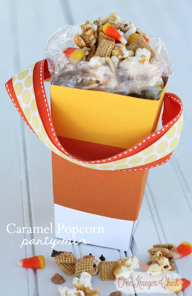 Caramel Popcorn Party Mix in a Candy Corn Popcorn Box...So cute! What a fun treat for a friend, teacher, neighbor or a movie night at home-Make your own today! OneKriegerChick