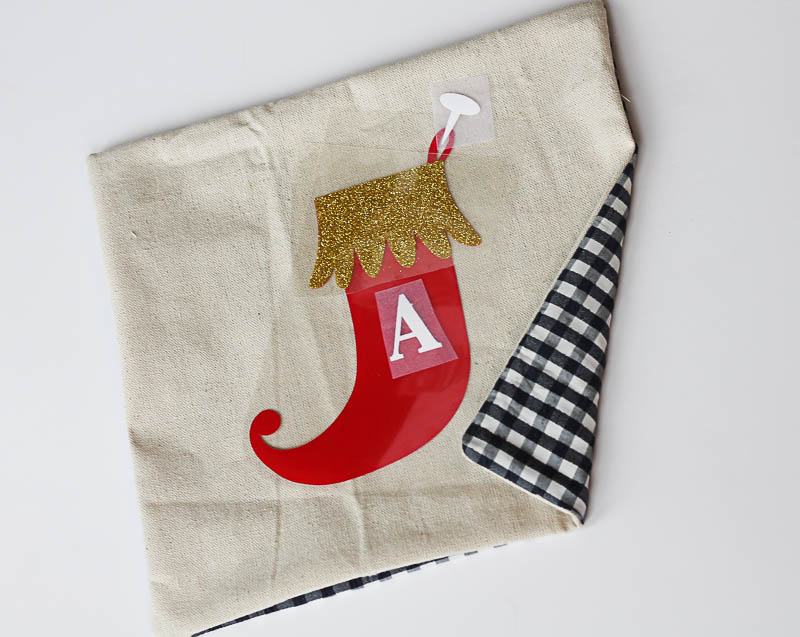 Make your own Monogram Christmas Stocking Pillows using Expressions Vinyl-Fun decor for kids rooms! 5-OneKriegerChick.com