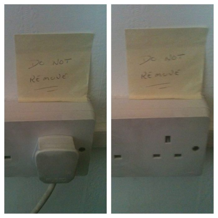 Do not remove plug sign