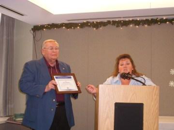Neil Zurcher presenting scholarship to Lynda Nemeth of WRTC who accepted for Jacob Fradotte