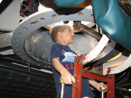 Jason Luttmann in conning tower hatch of USS Cod