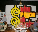 "Customers love to pose by ""Price is Right"" sign from the TV Show"