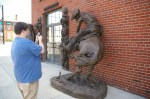 Even when the galleries are closed tourists can snap photos of the sidewalk sculptures