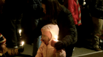 kids lighting candles