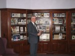 John Herzig standing in front of part of his funeral collection
