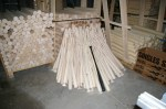 Pile of finished baseball bats waiting to be boxed and shipped