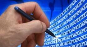hand with stylus touching binary code