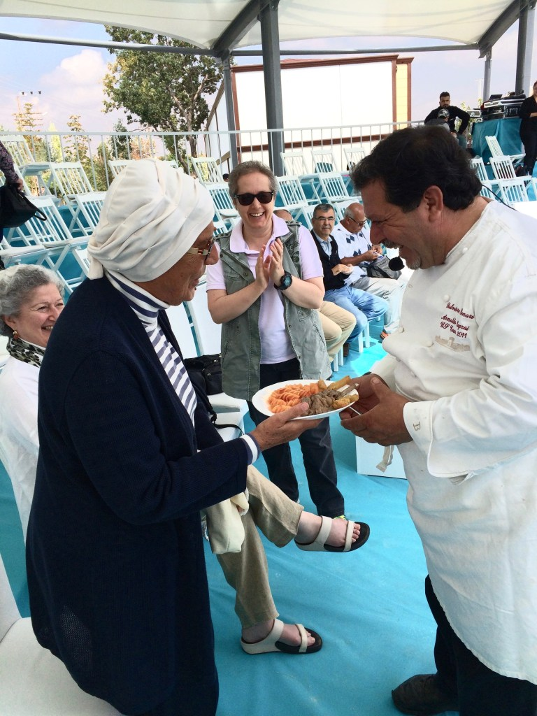 Salvatore Denaro, Italy, giving a taste to Mrs. Nevin Halici, Turkey's august cookbook writer and scholar
