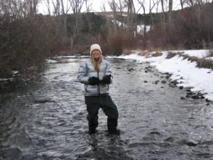 Bri in Little Blackfoot River in Montana - on the horizon line - clark fork coalition