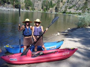 brianna randall  and cass kayaking the salmon river - on the horizon line