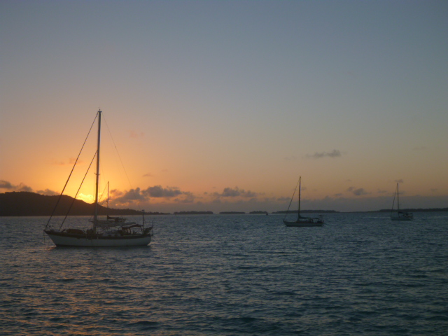 sailboats at sunset south pacific travel