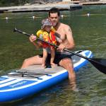 rob roberts and talon on a standup paddleboard on flathead lake