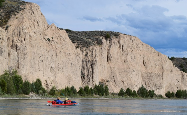 Scenic cliffs on the lower Flathead River, full of swallows sailing through the sky.