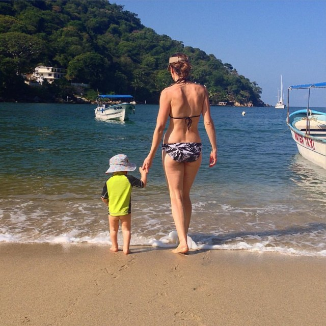 Checking out the waves in Boca de Tomatlan, perfect for babies and mamas.