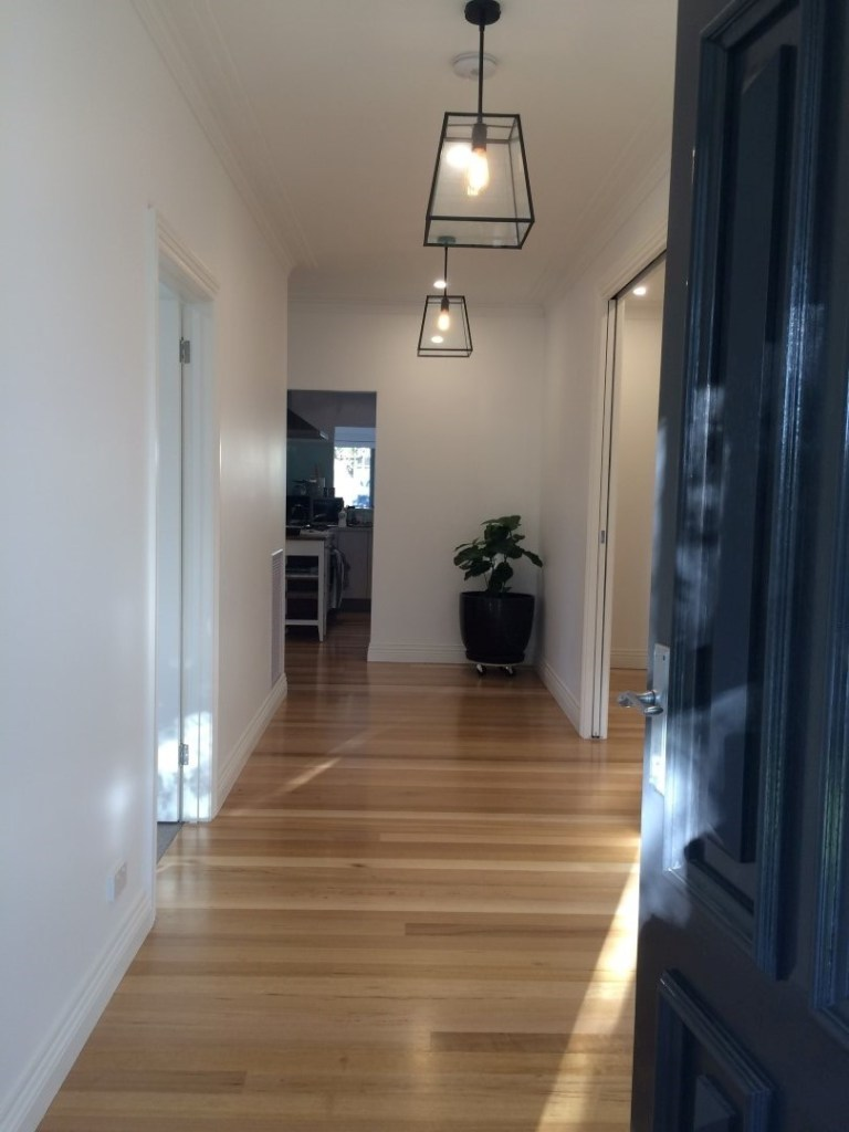 Gleaming Tasmanian oak floorboards with a 'high traffic' finish.