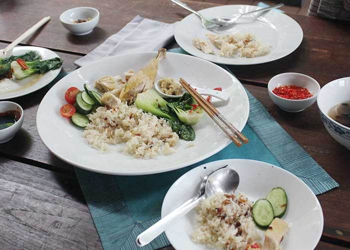 Family meal of Hainanese chicken rice