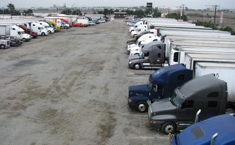 Semi-truck, trailer, flatbed, car-carrier, bobtail truck parking in