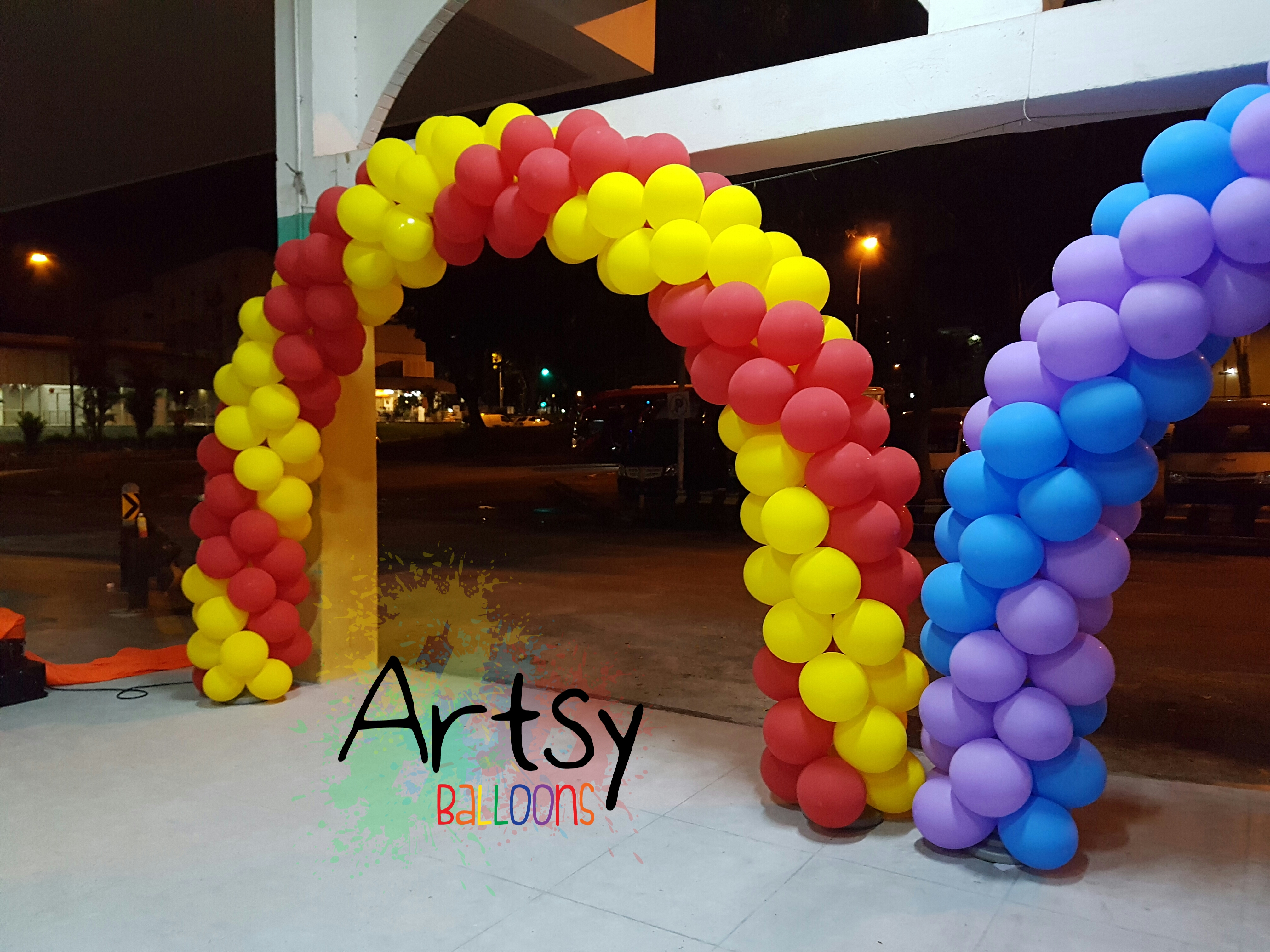 image Red and yellow spiral balloon arch