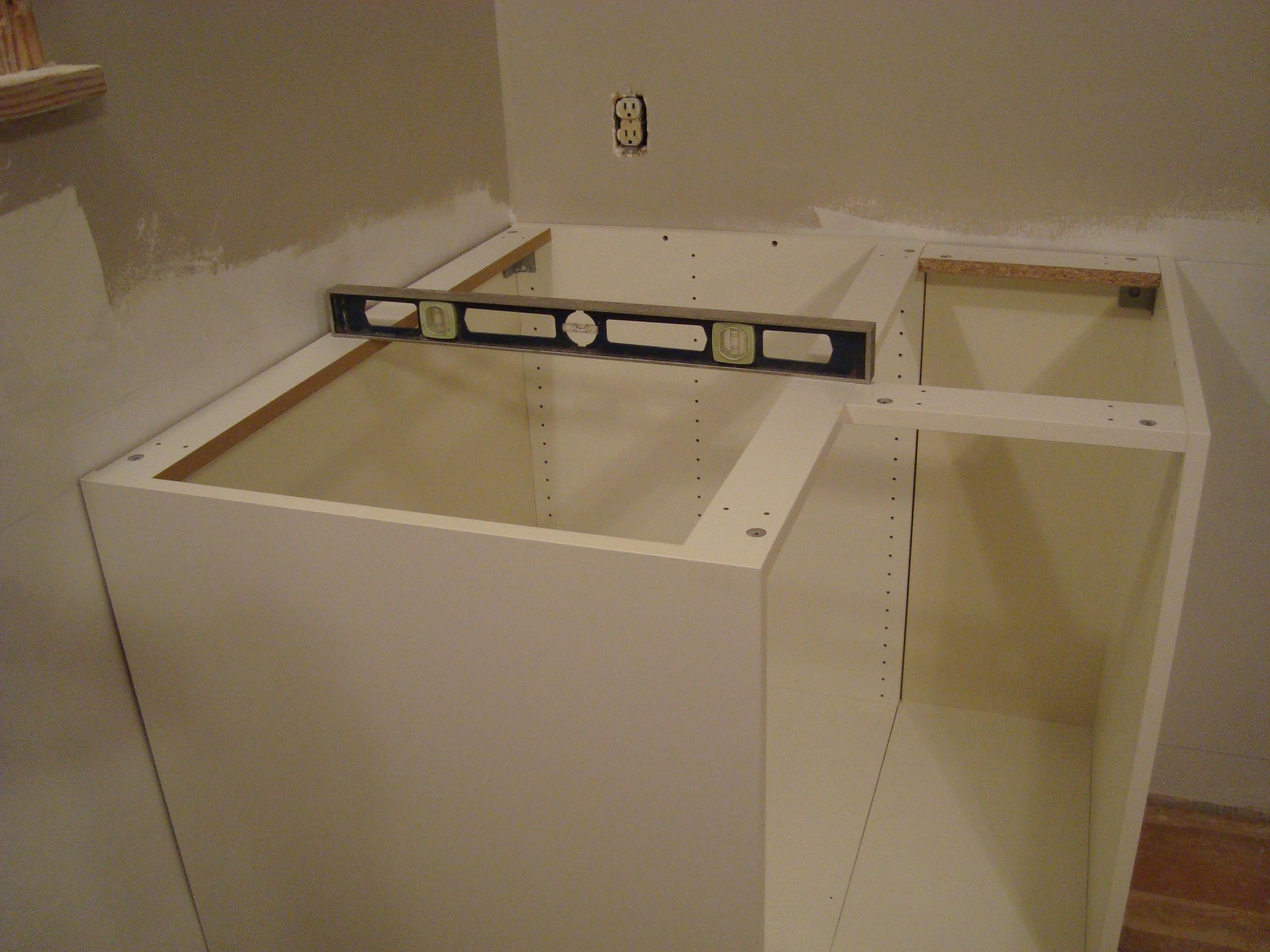 an och 10 step program installing kitchen cabinets kitchen sink base cabinet Step 7 Cut openings for plumbing in sink base