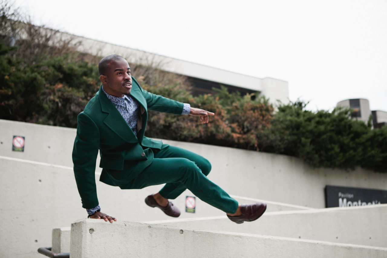 ottawa fashion monochrome outfits, all green suit, burgundy loafers, black male model, dynamic model pose, handsome black man