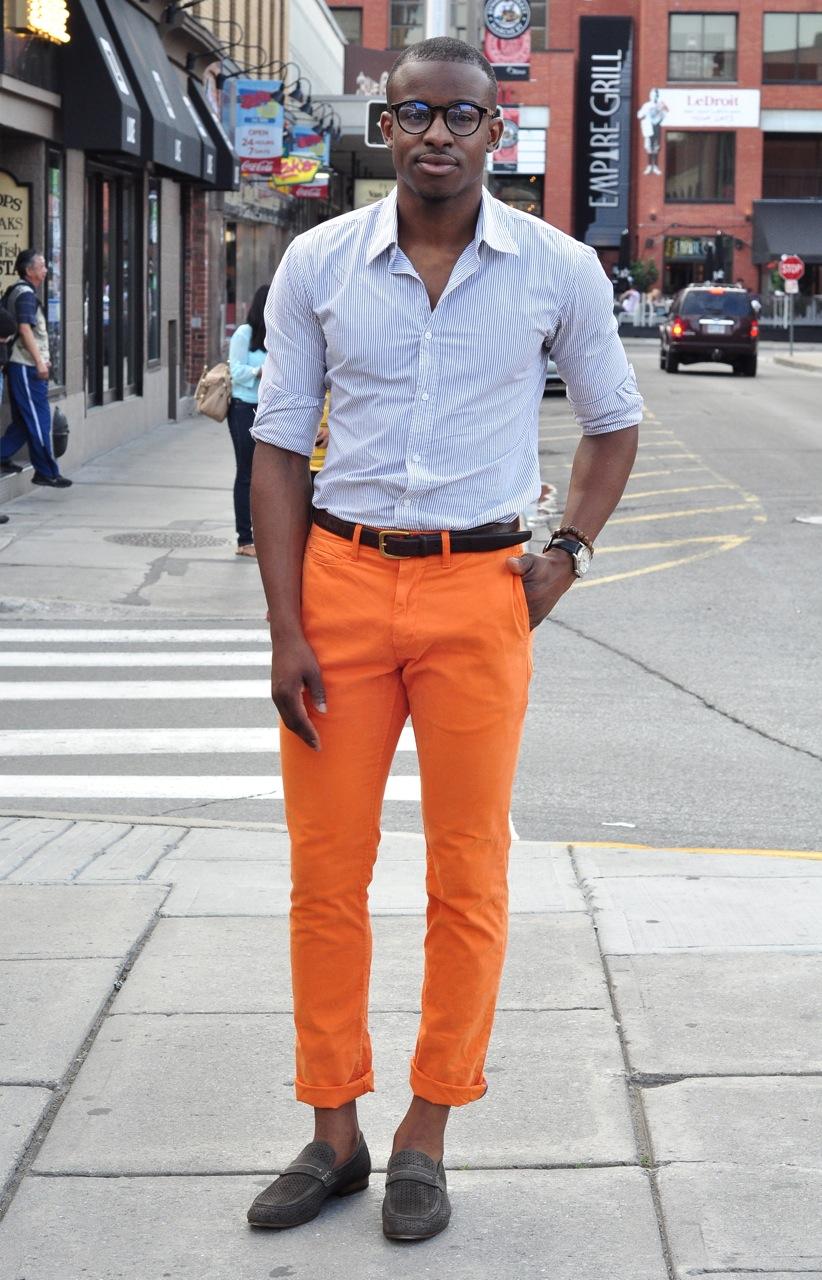 mens orange pants, mens orange pants street style, pinstripe shirt, GQ, mens horn rimmed glasses, handsome black man
