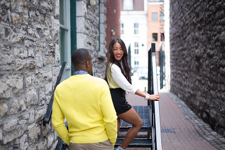yellow and blue color blocking, couples matching outfits, yellow cardigan, black high waisted short, mens floral shirt, black and asian couple, interracial couple, stylish couple, ottawa fashion