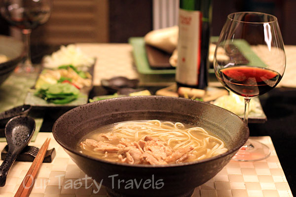 Pho with noodles and pork on top http://ourtastytravels.com/blog/asian-cooking-at-home-vietnamese-pho-recipe/ #recipe #ourtastytravels