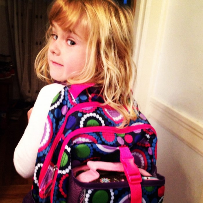 Trying her new backpack for kindergarten