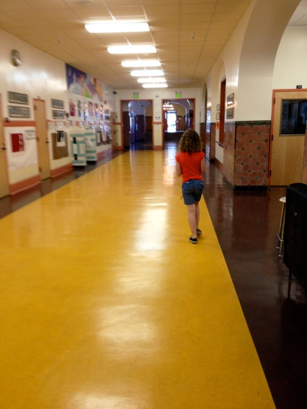 Walking through Mission High School on her way to work with Chef Michelle McKenzie on a TV show