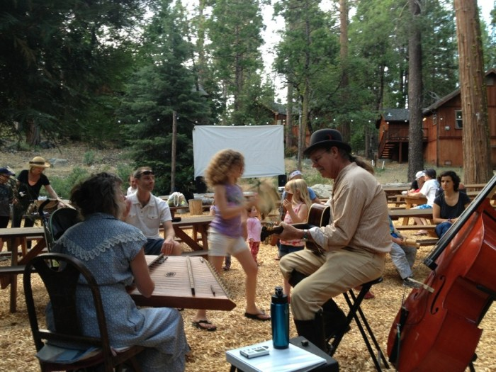 Jamming with the little folk duo. They had a movie outside when it got dark.