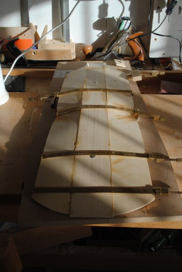 Glueing together the central staves of the belly