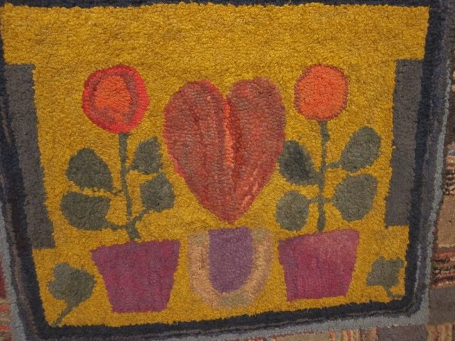 172: Hooked Rug with Heart Motif