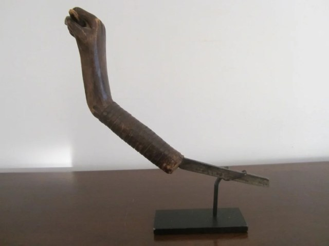 230: Iron and Wood Crooked Knife in Form of Fist Effigy