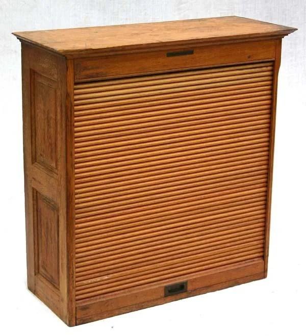 280: antique oak roll front cabinet labeled Library Bur