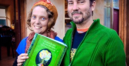 Lachlan McKenzie with Emily Gray and the guidebook East Timor edition.
