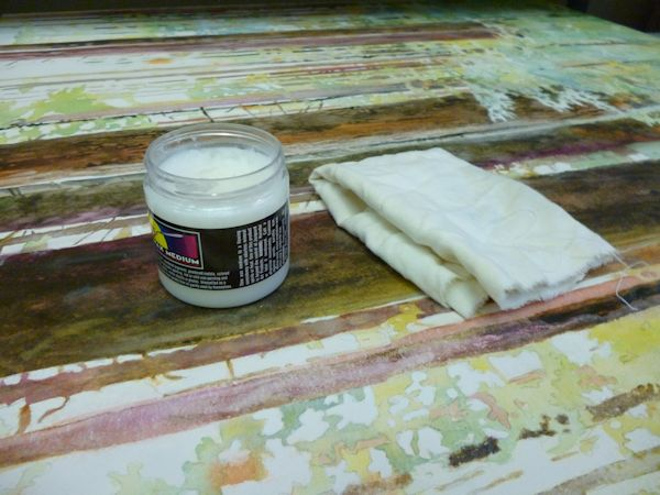 finishing a watercolor painting with wax