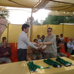 Chairman SAS, Ezatullah, presenting Shiled To Eng. Ghulam Karim as a token of appreciation to Late Rai Ghulam Uddin