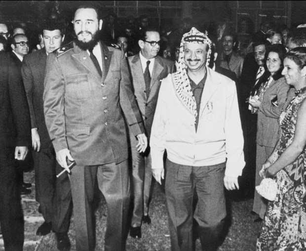 LA HABANA, CUBA - DECEMBER 14: The Palestine Liberation Organization (PLO) chairman Yasser Arafat (R) walks nearby Cuban leader Fidel Castro during his visit in Cuba in December 1974. Yasser Arafat found the Palestine Liberation Movement or Fatah in Kuwait in 1959 and gained control over the PLO in 1969. (Photo credit should read STF/AFP/Getty Images)