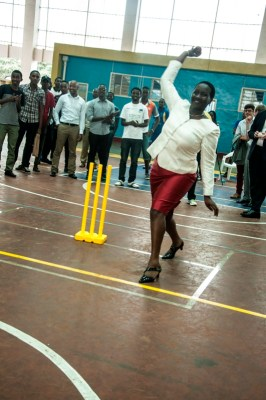 Minister of Sports and Culture Julienne Uwacu trying out his bowling skills. (Photo by Jejje Muhinde)