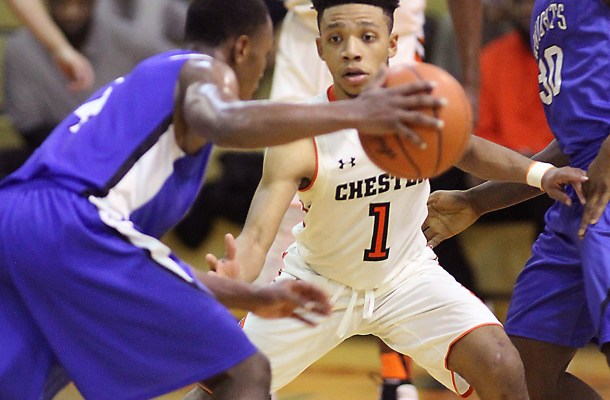Chester's Khaleeq Campbell, right, defends Jawan Collins Tuesday night. Campbell scored 13 points to lead Chester to a 72-57 win. (Digital First Media/Robert J. Gurecki)