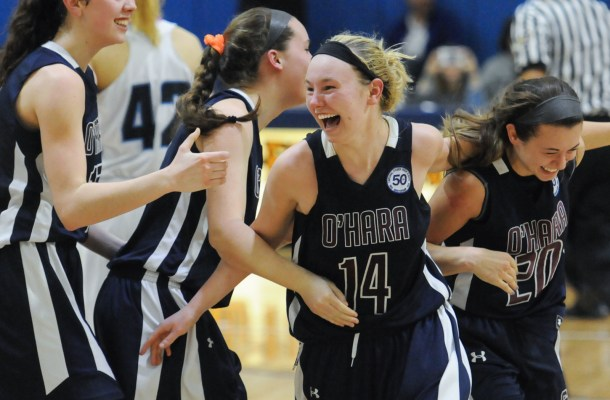 Cardinal O'Hara players (from left) Mary Sheehan, Emily Helms, Mackenzie Gardler and Hannah Nihill celebrate their 48-41 victory over North Penn Tuesday night in the PIAA Class AAAA semifinals at Spring-Ford. (John Strickler - Digital First Media)